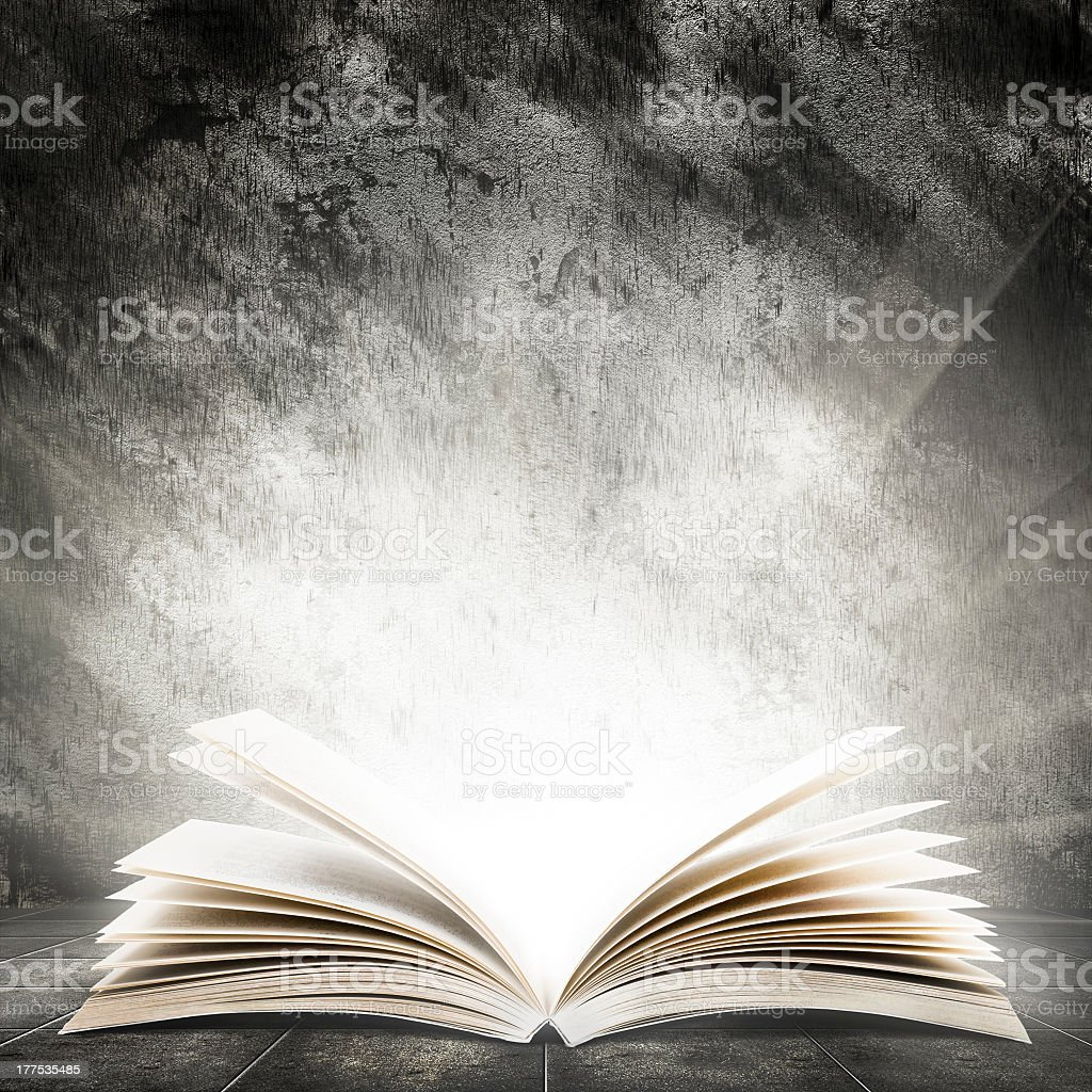 An open book illuminating a very bright light stock photo