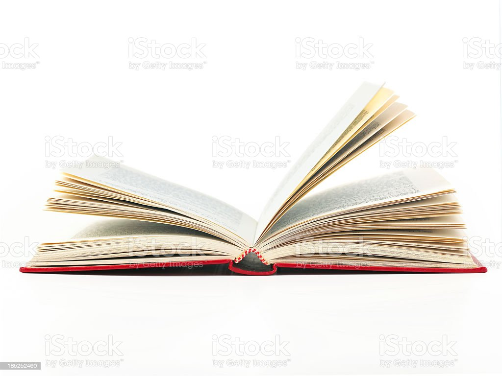 An open book with red cover on a white background stock photo