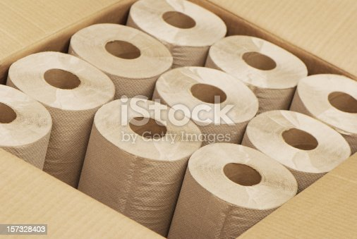 Rolls of paper towels made from recycled paper in cardboard box