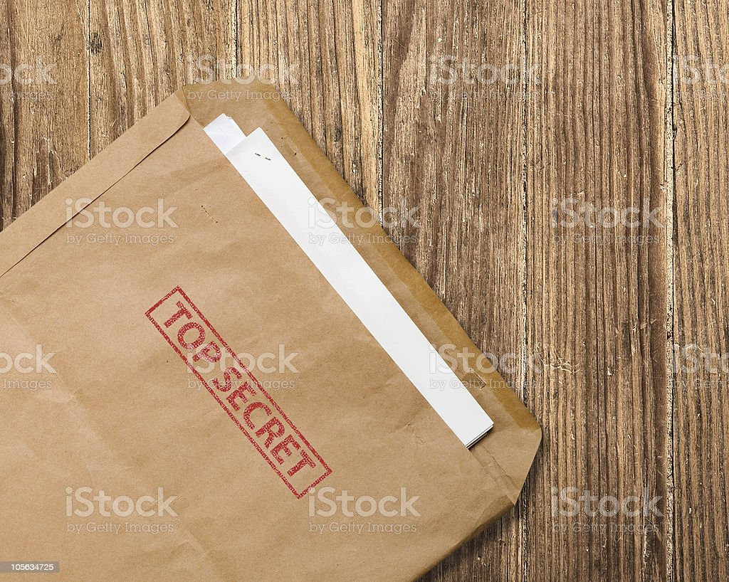 An open top secret envelope on the table stock photo