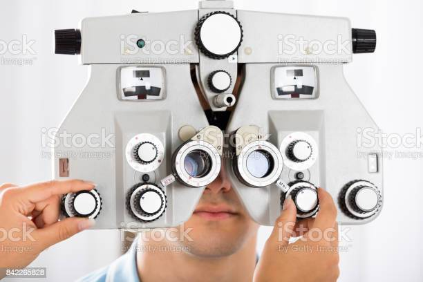 An optometrist adjusting phoropter for patient picture id842265828?b=1&k=6&m=842265828&s=612x612&h=6gwdoskvrr0wts9ct3hz ezbolepwvseqtlsoshgi4q=