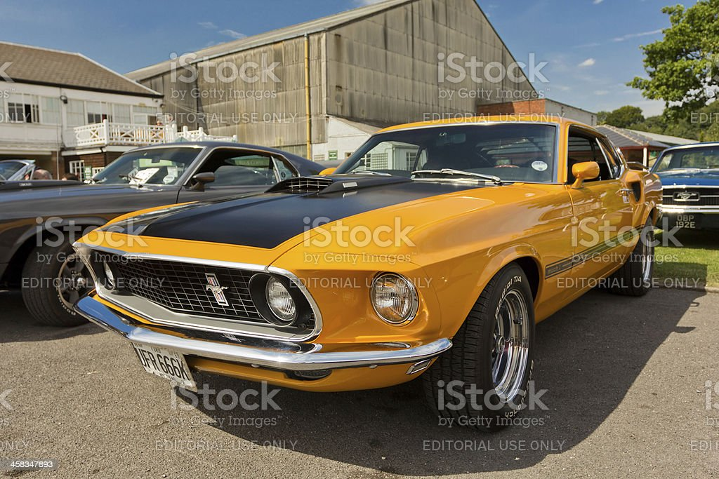 An orange 1969 Ford Mustang Shelby stock photo