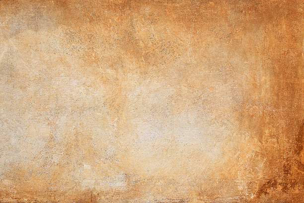 an orange and brown wall texture background - patina stockfoto's en -beelden