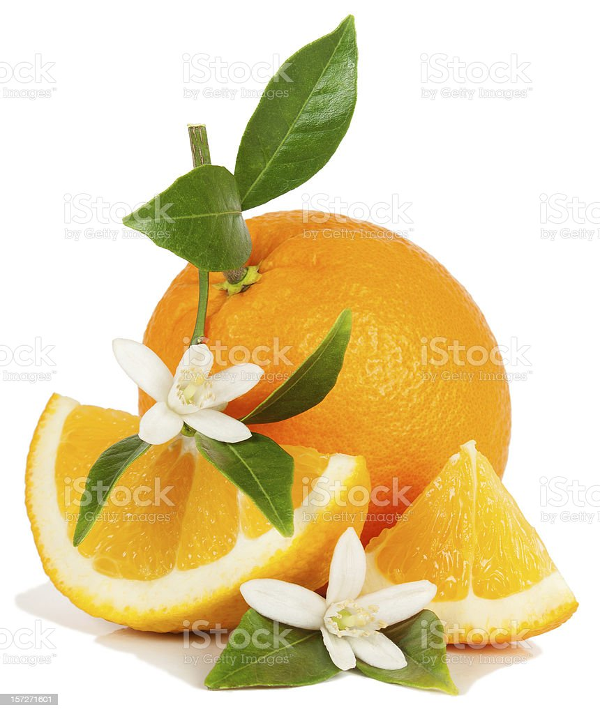 An orange and some slices with white flower garnishes stock photo