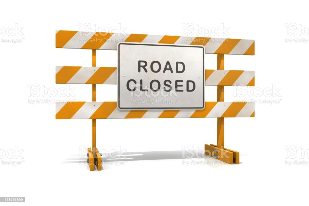 An orange and white road closed barricade sign stock photo