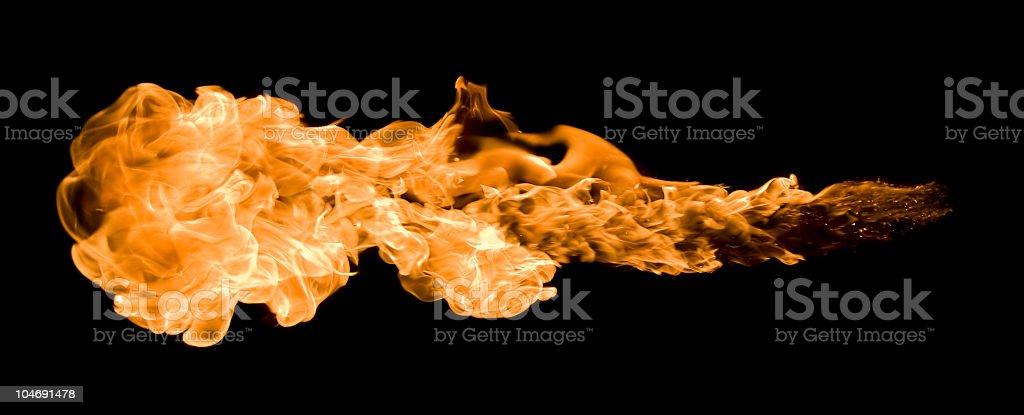 An orange blazing fire ball across a black background royalty-free stock photo