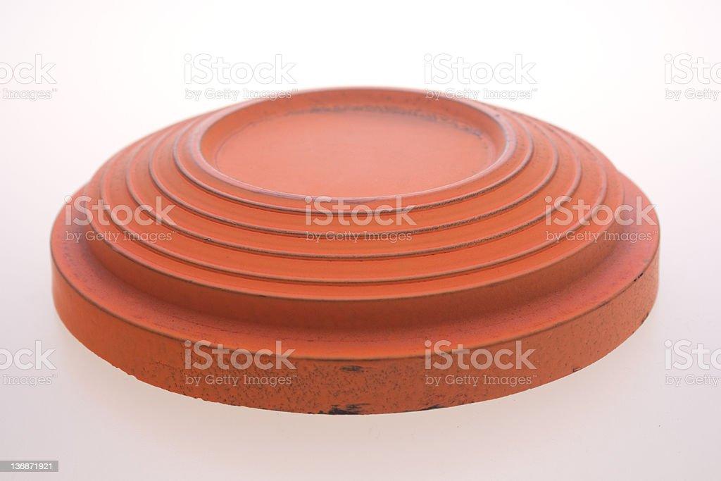 An orange clay pigeon trap shooting target  stock photo