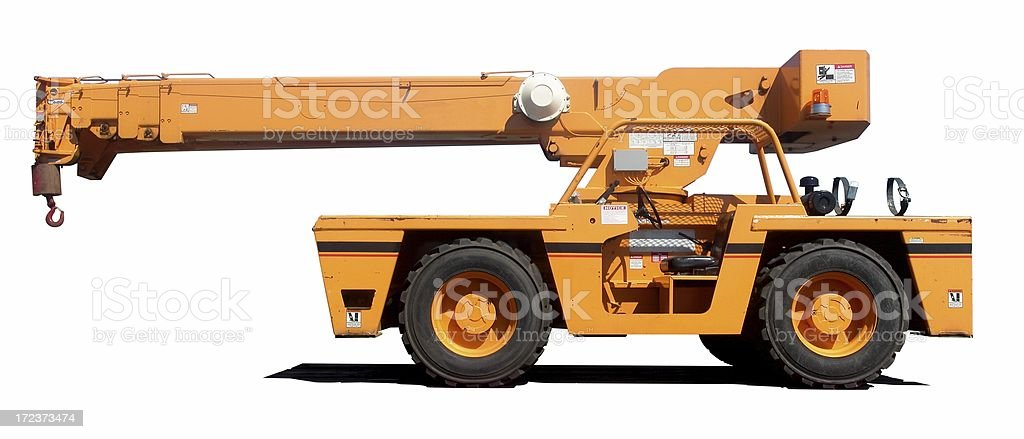 An orange crane with it's shadow on a white background stock photo