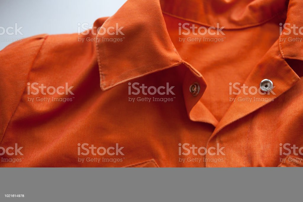 An orange jumpsuit of a prisoner. Serving of compulsory execution of court decisions stock photo