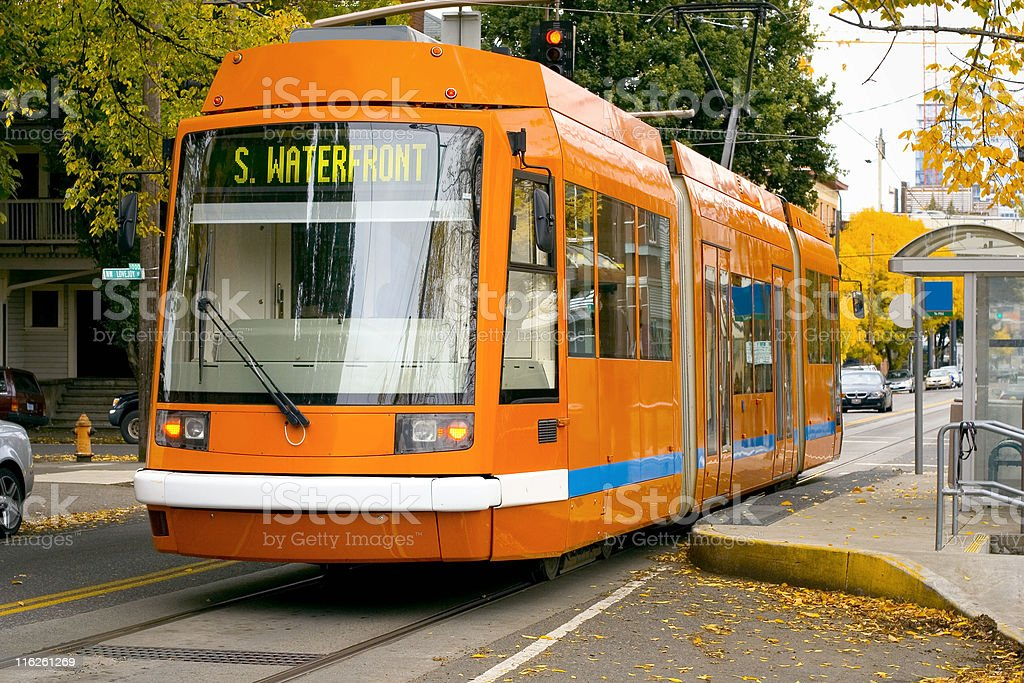 An orange Portland streetcar for the S. Waterfront route royalty-free stock photo