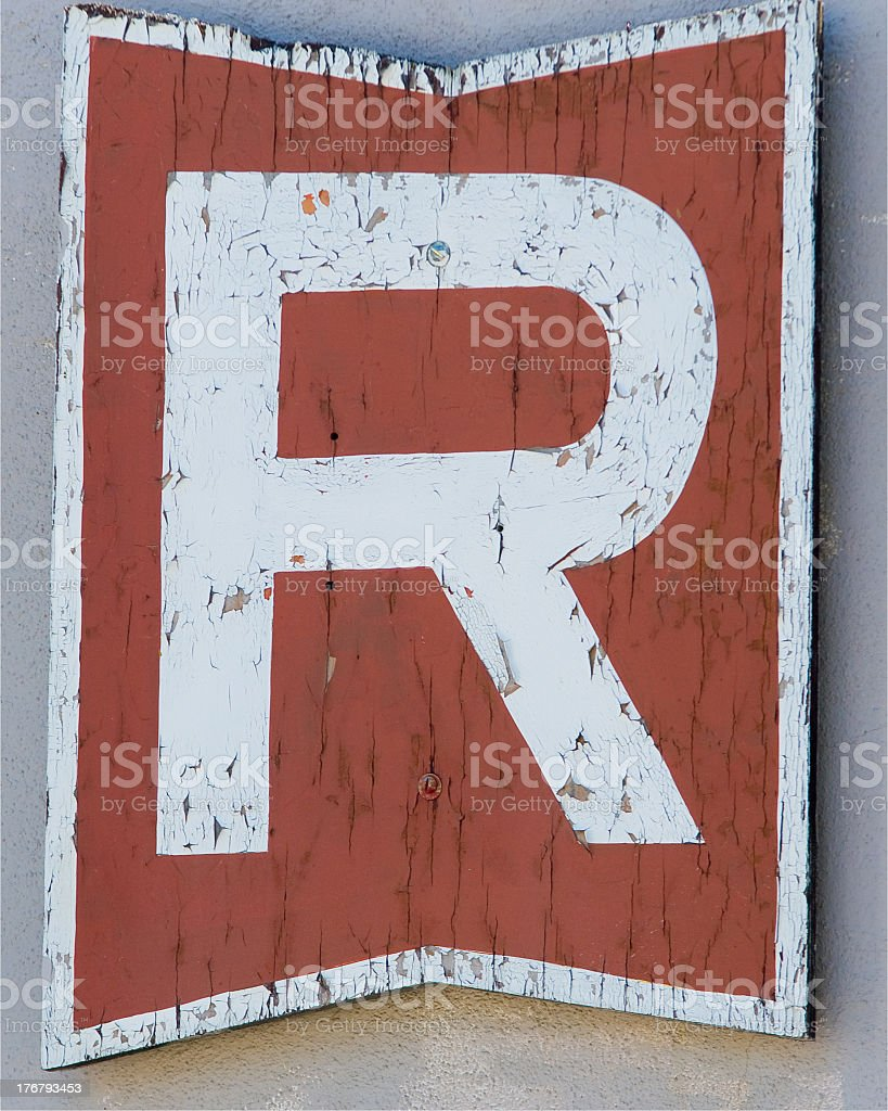 An orange sign with the letter R stock photo