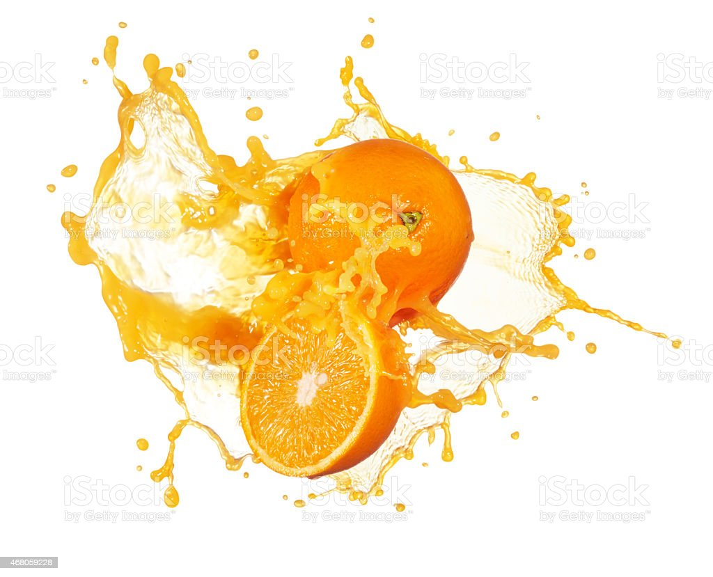 An orange slicing in half and splashing juice stock photo
