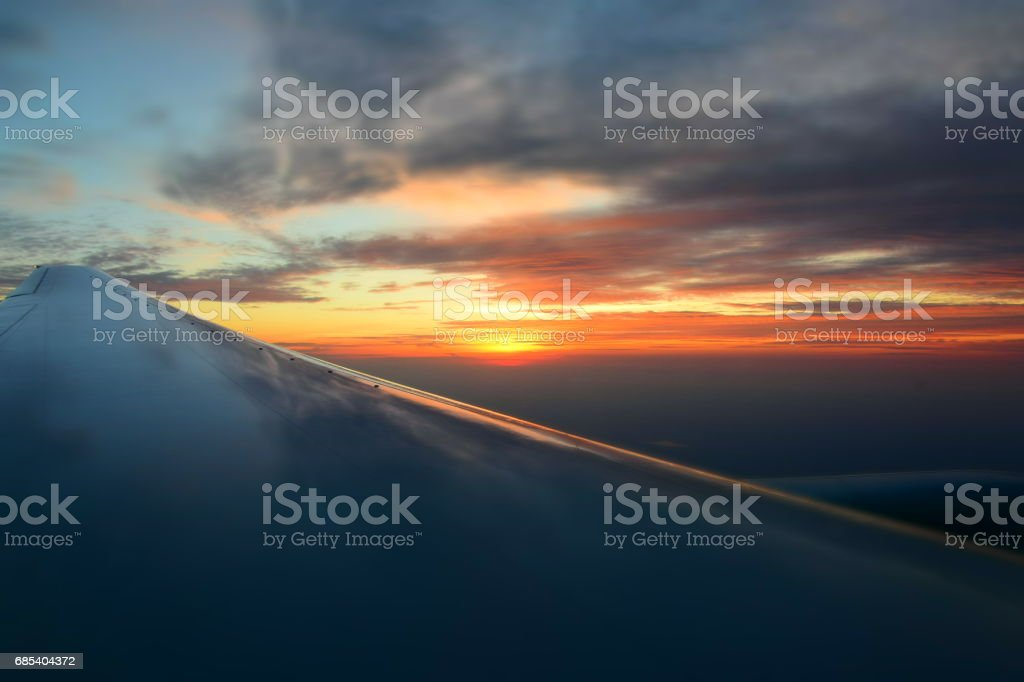 An orange sunset from an airplane stock photo
