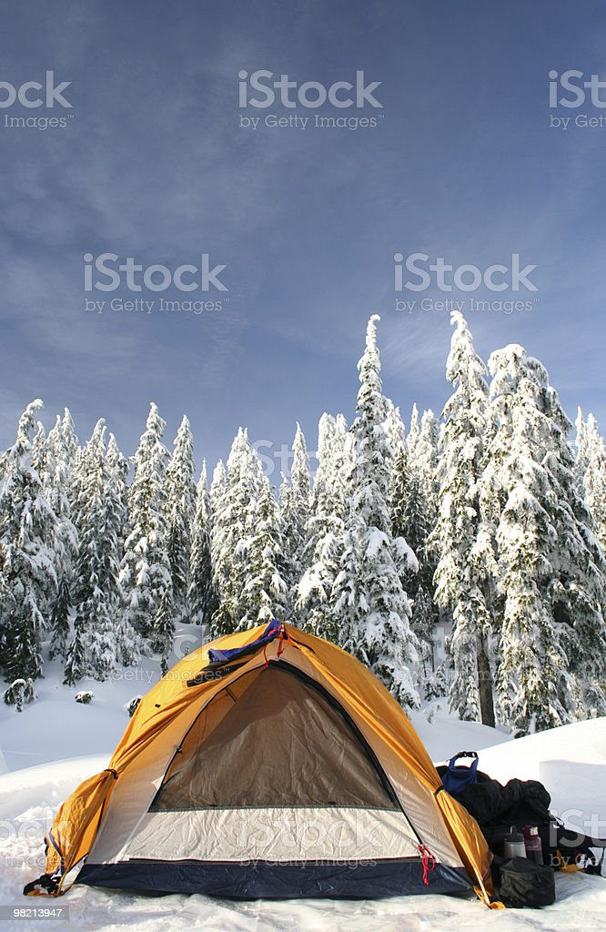 An orange tent set up in a snowy trail royalty-free stock photo