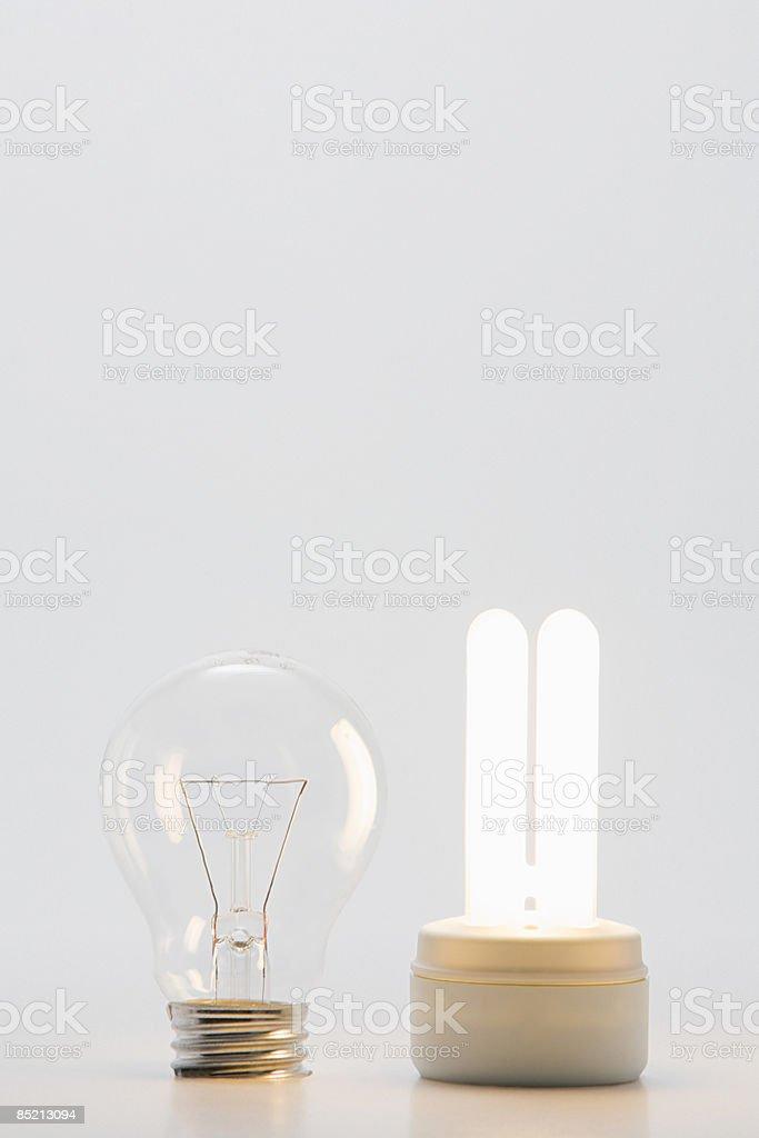 An ordinary and energy saving lightbulb royalty-free stock photo