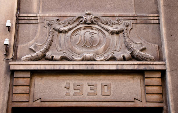 an ornament above the entrance door - art deco stock photos and pictures