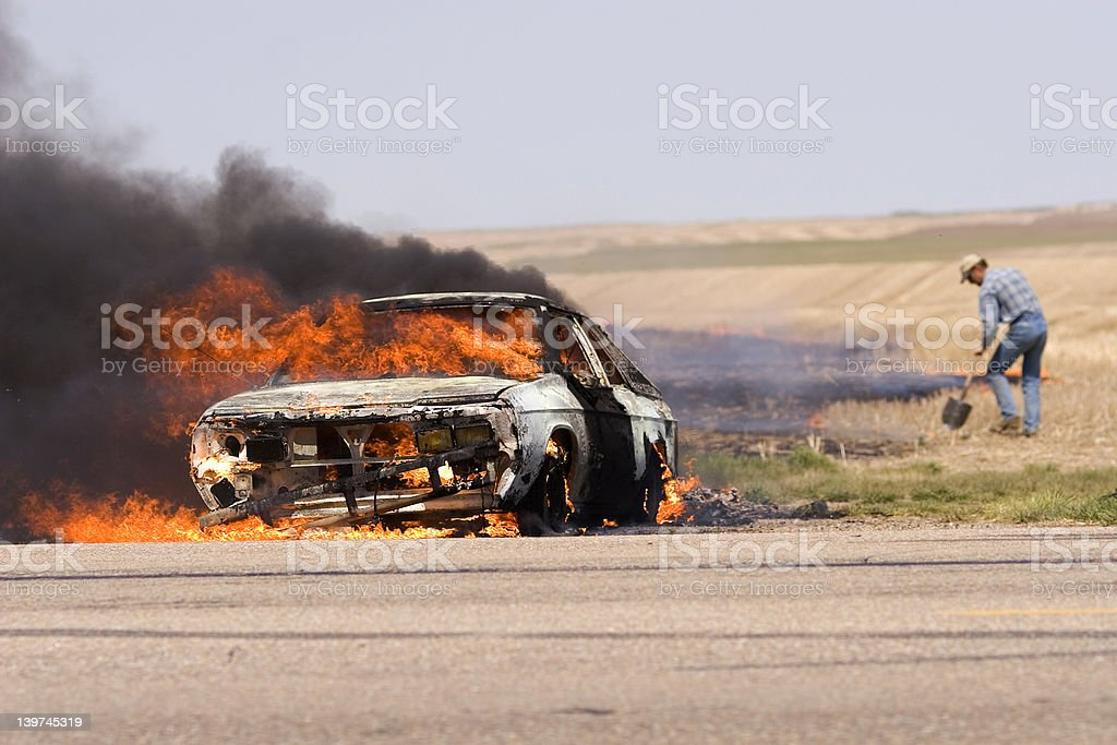 An out of control car that set on fire stock photo