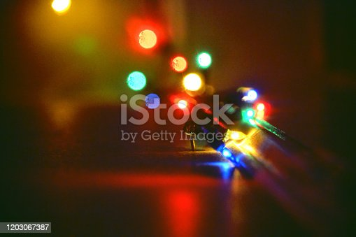 889246424 istock photo An out of focus string of Christmas lights 2 1203067387
