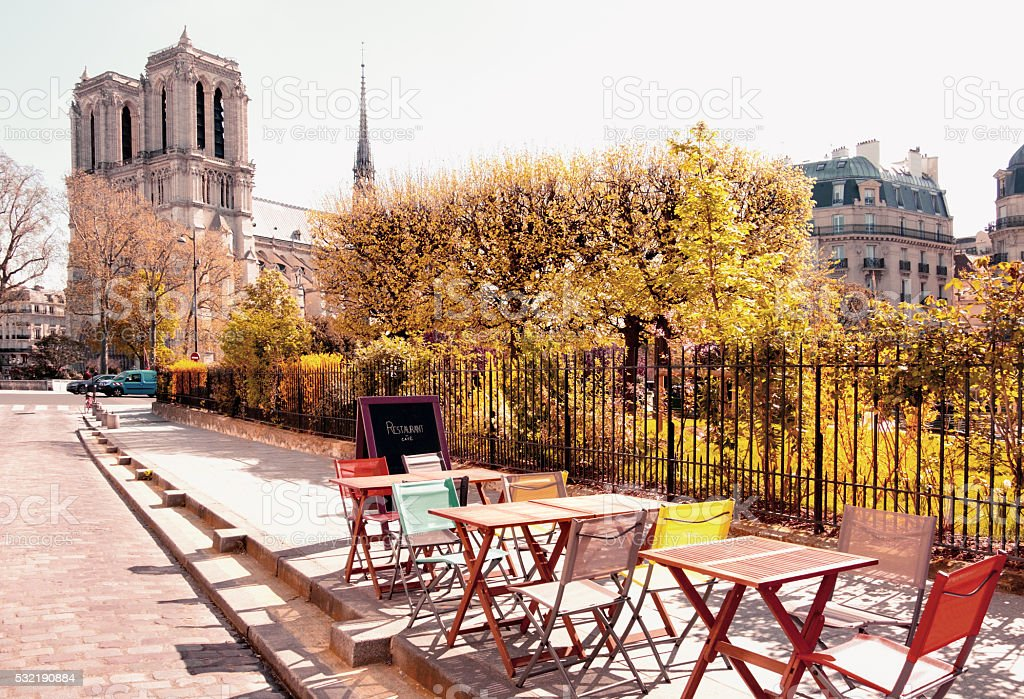 An outddoor cafe next to Notre Dame Cathedral in Paris stock photo