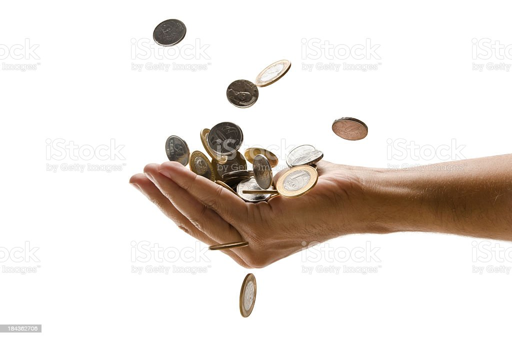 An outreached hand catching a pile of falling Euro coins stock photo