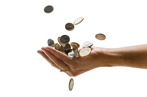 An outreached hand catching a pile of falling Euro coins Hand catching falling coinsREAL $ Brazilian money refund stock pictures, royalty-free photos & images