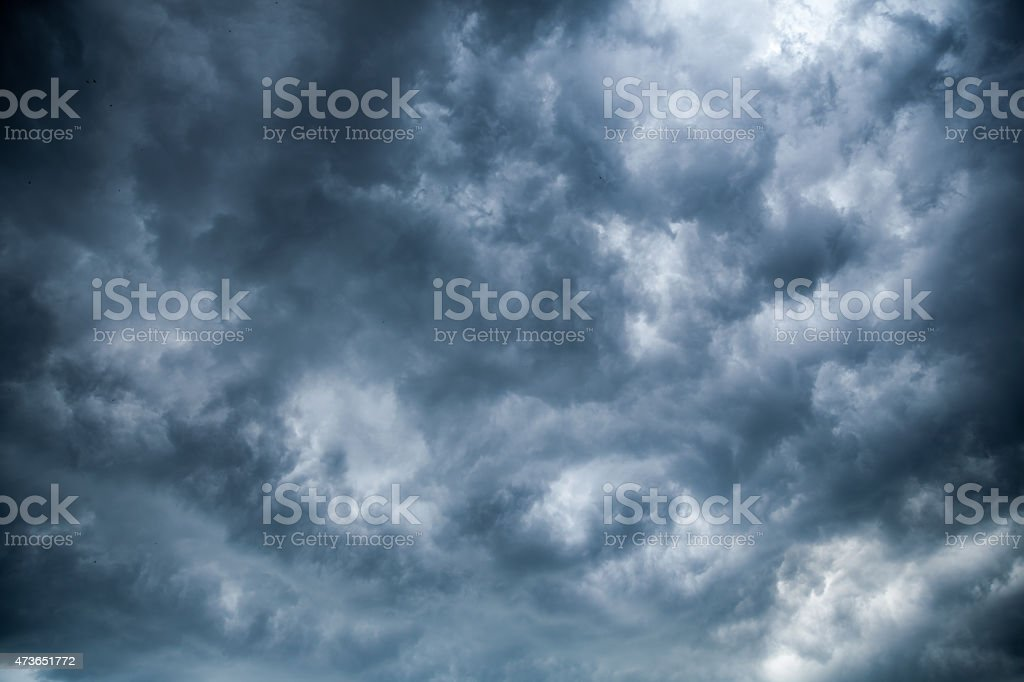 An overcast sky of dark grey clouds stock photo