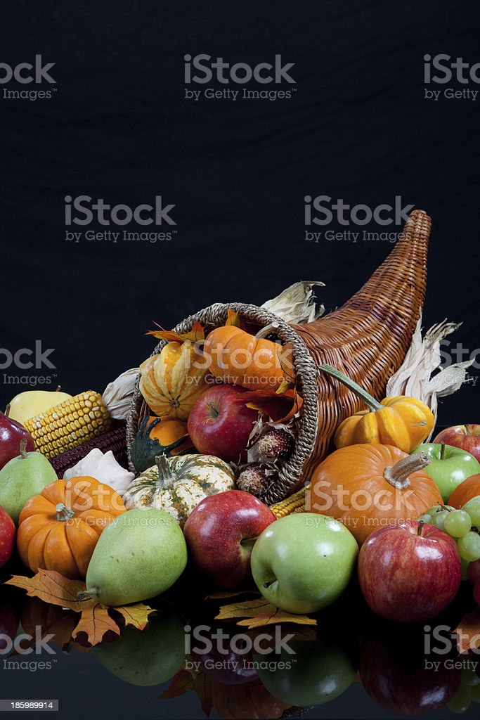 An overflowing cornucopia on a black background royalty-free stock photo