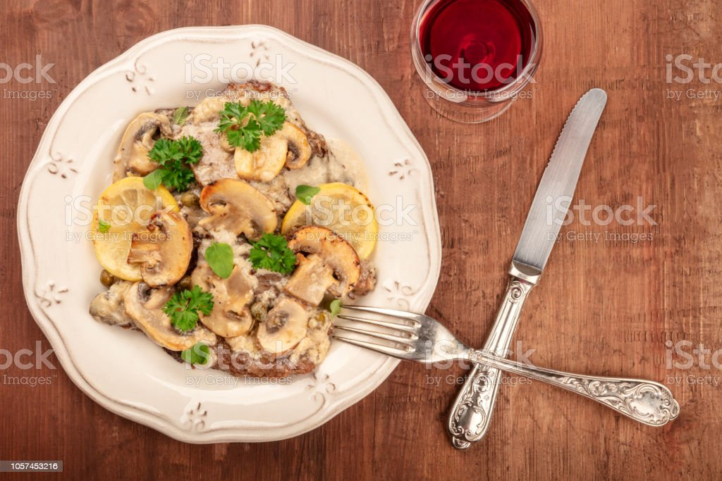 An Overhead Photo Of Scallopine Di Vitello Veal Scallopini With A Mushroom Sauce Lemons And Parsley On A Dark Rustic Wooden Table With Red Wine And Copyspace Stock Photo Download Image,How To Clean A Plastic Bathtub