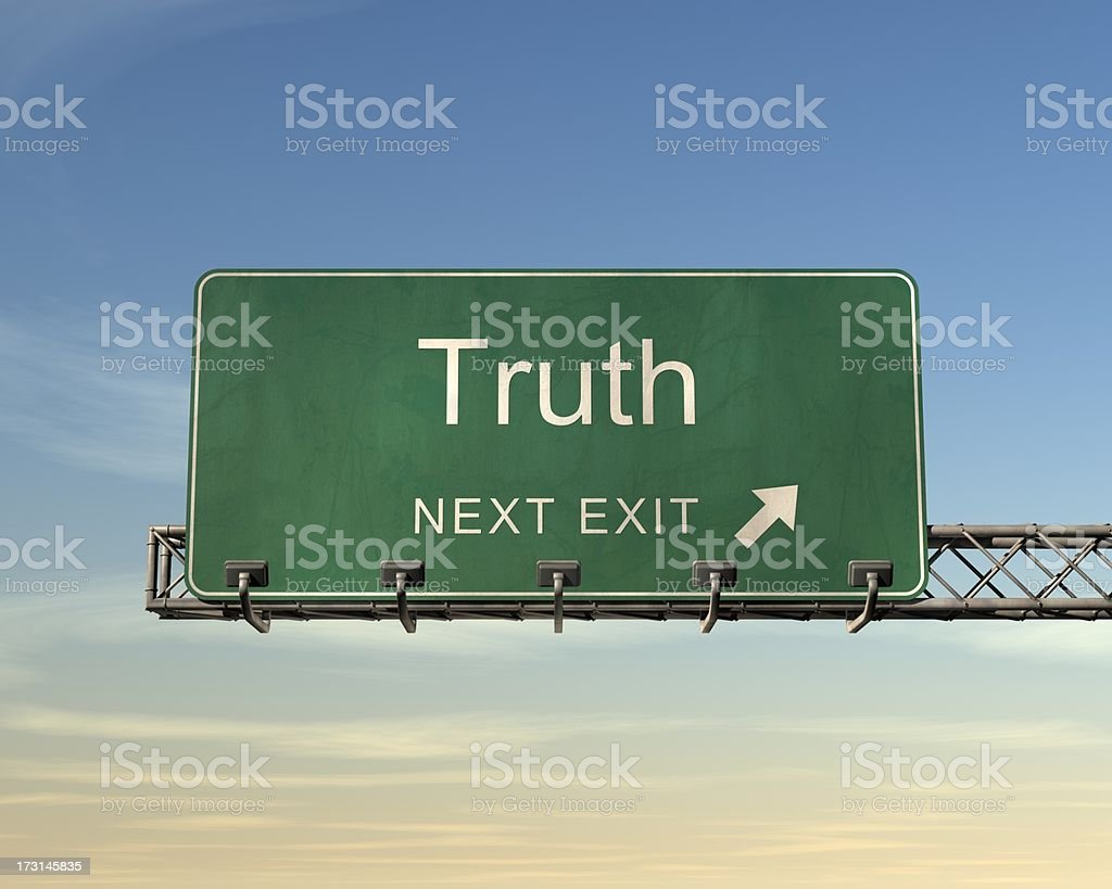 An overhead road sign in green of the word Truth  royalty-free stock photo