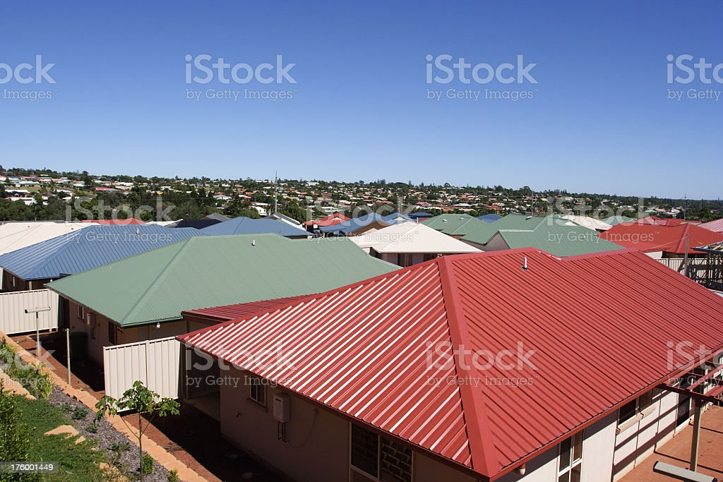 An overhead shot of metal roofs in crowded suburbia stock photo