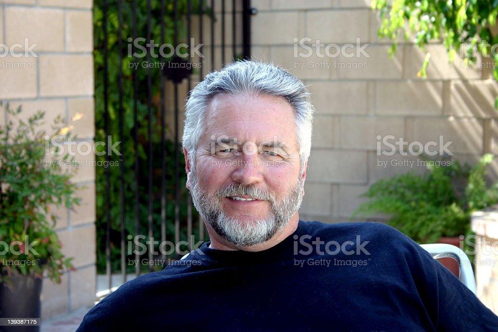 An senior man satisfied enjoying his early retirement stock photo