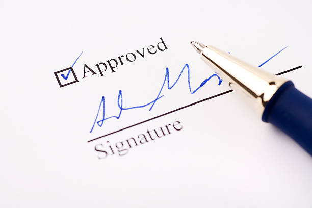 an signature under an approved check mark - permit stock photos and pictures