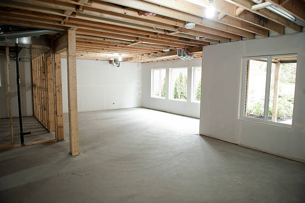An unfinished basement in someone's home being built stock photo