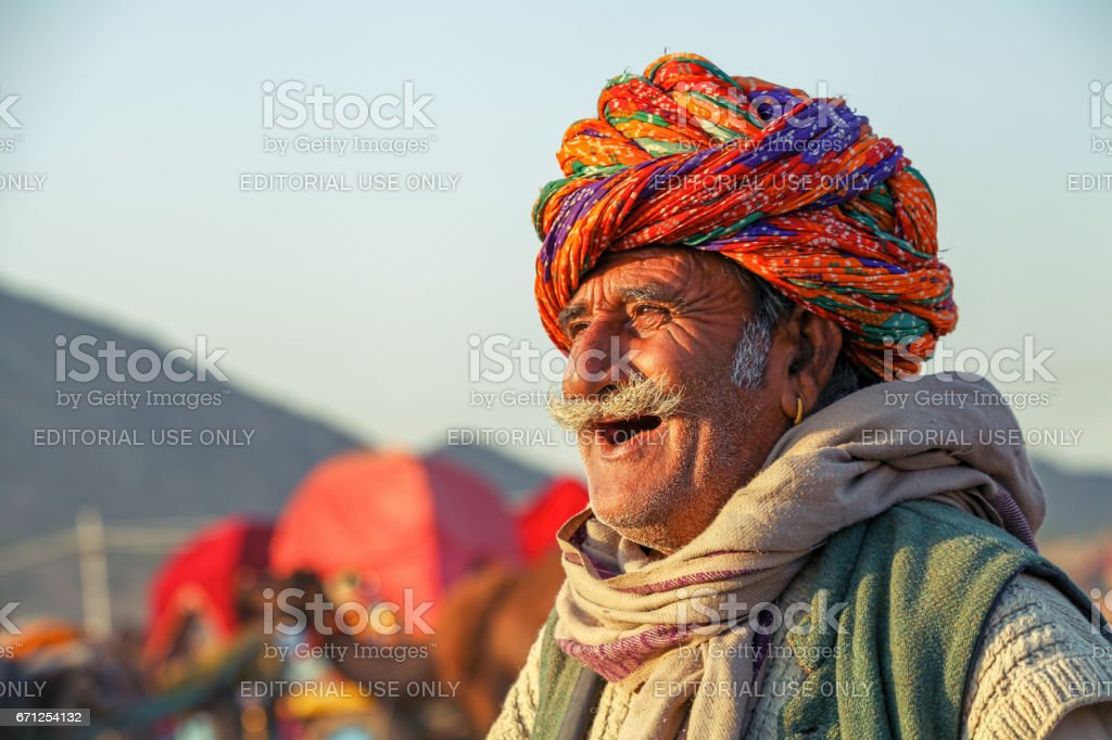 An unidentified happy and smiling old man at Pushkar Camel Fair stock photo