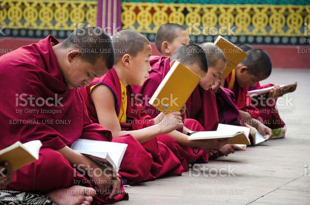 An Unidentified Tibetan lama prays mantra at Ramtek Monastery in Gungtok, Sikkim, India stock photo