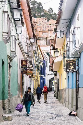 An unidentified woman walk along Jaen street, a colonial cobbled street in La Paz, Bolivia