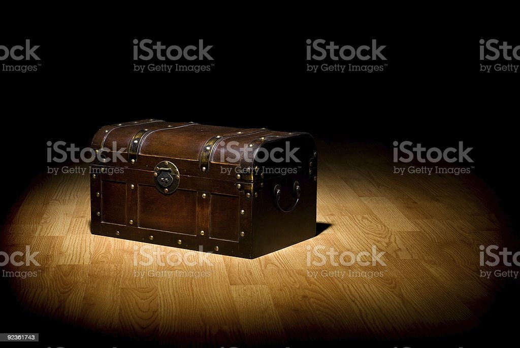 An unopened treasure chest in the spot light royalty-free stock photo