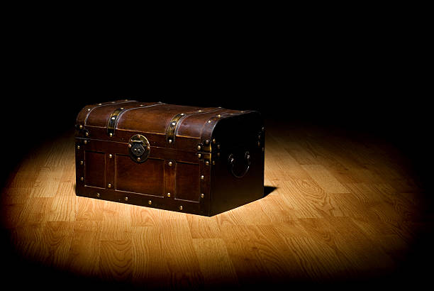 An unopened treasure chest in the spot light stock photo