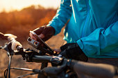 istock An unrecognizable mountain biker attaching his phone to a bike mount 1185937663