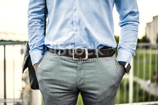 istock An unrecognizable young businessman with a bag walking on a bridge. 1030371466