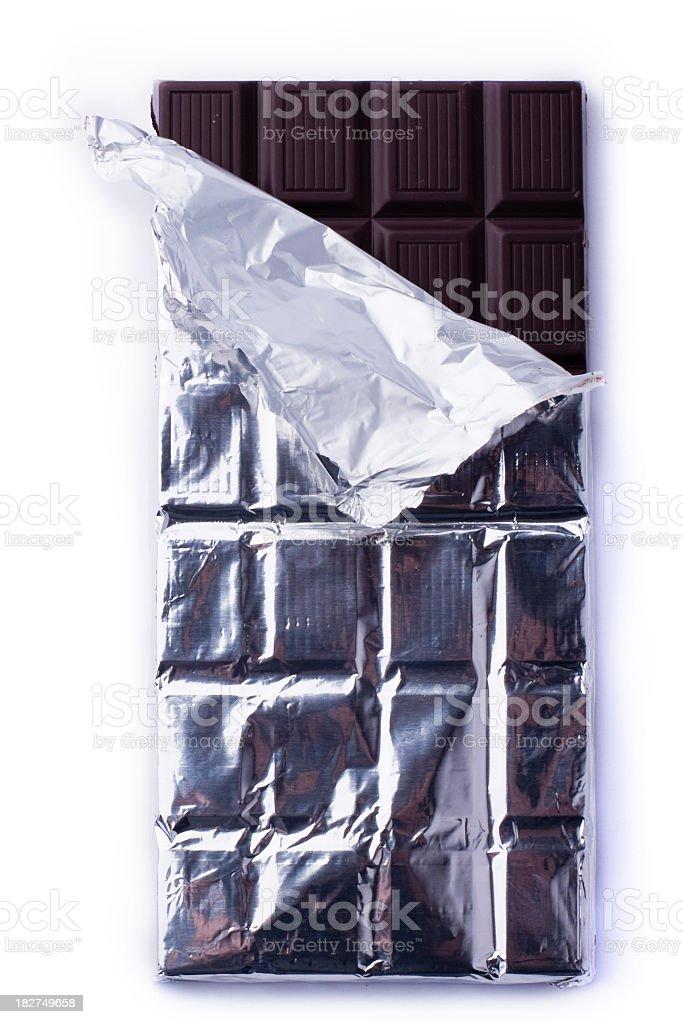 An unwrapped dark chocolate bar stock photo