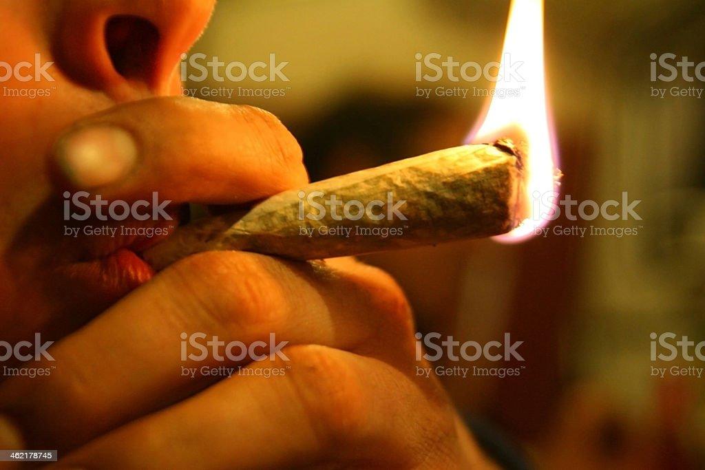 An up close image of a person smoking marijuana stock photo