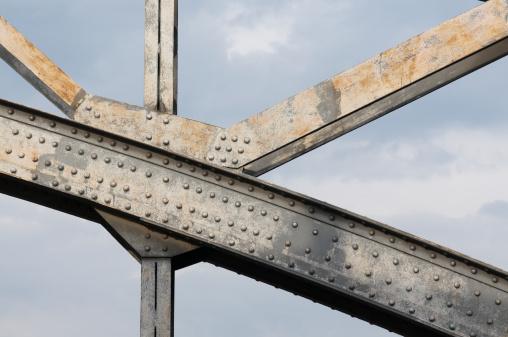 Detail of steel bridge in front of blue sky
