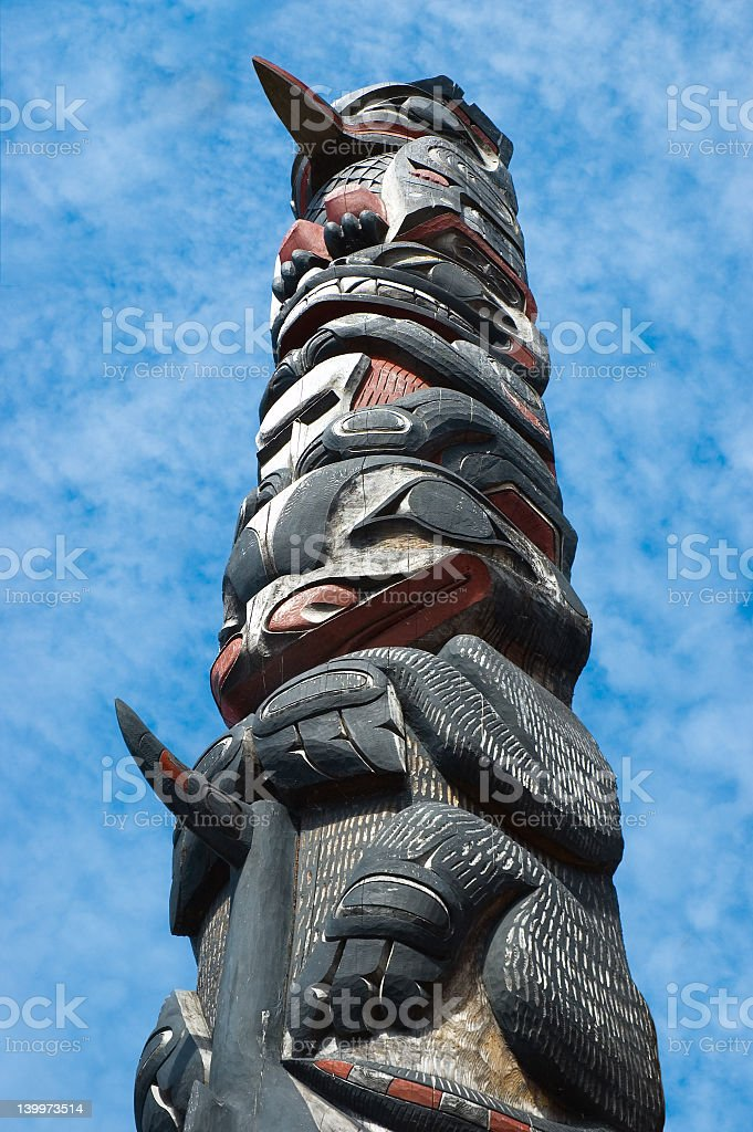 An up close picture of a totem pole stock photo