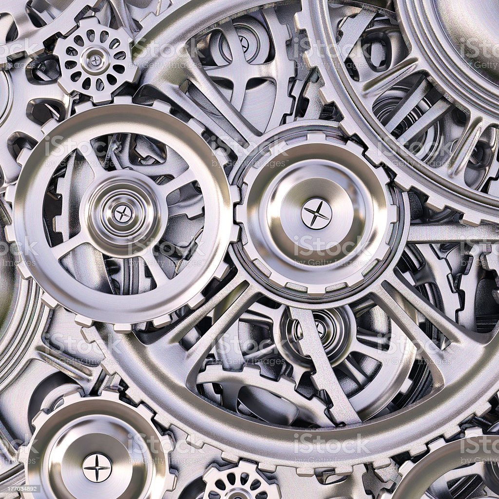 An up close picture of silver gears stock photo