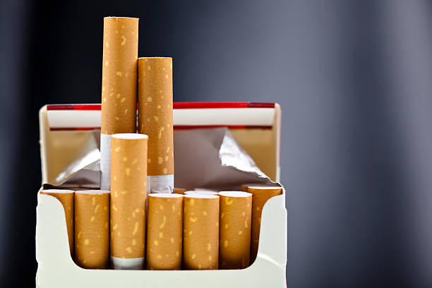 An up close view of a package of several cigarettes  stock photo