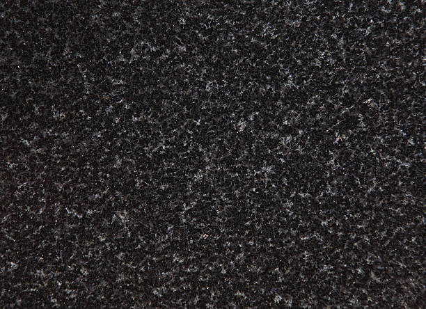 An up close view of black and grey speckled granite  Black granite conglomerate texture granite rock stock pictures, royalty-free photos & images