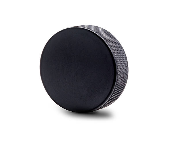 an upright hockey puck isolated on white background - hockey puck stock photos and pictures