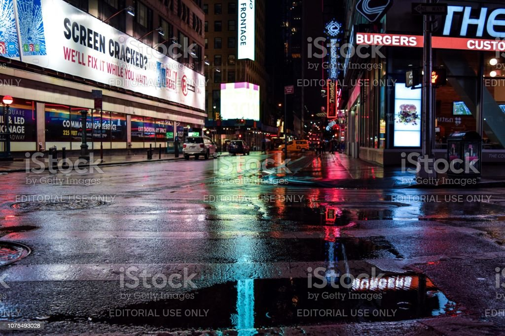 An Upside Down Reflection Picture of Times Square at Night stock photo