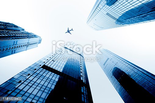 An upward view of the city's skyscrapers gathering.